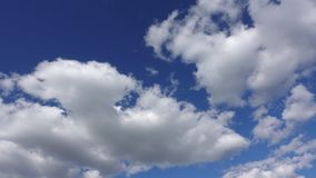 White clouds in the blue sky, Time-lapse 4K. Beautiful sky on a Sunny day.  stock video