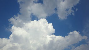 White clouds in blue sky stock video footage
