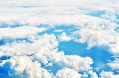 White clouds and blue sky view from airplane window. Royalty Free Stock Image