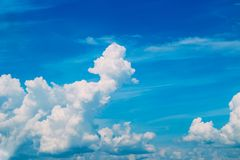White clouds in the blue sky. Landscape of clouds above the ground royalty free stock image
