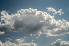 White clouds on blue sky. At summer with sunshine royalty free stock photos