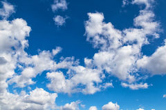 White clouds on blue spring sky Stock Images