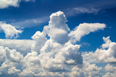 White clouds and blue summer sky Stock Photography