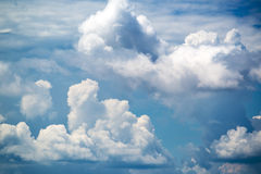 White clouds and blue summer sky Stock Photos