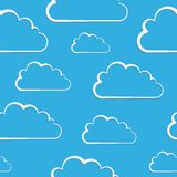 White clouds on blue. Vector seamless pattern Stock Photos