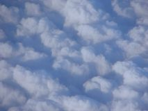 White Clouds in Blue Sky - Abstract Background. This is an image of white clouds dispersed in blue sky as captured while traveling in air Royalty Free Stock Image