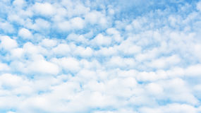 White clouds on a bright blue sky. Stock Photography