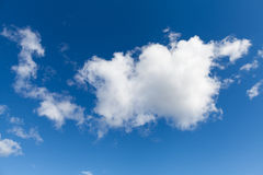 White Clouds on Bright Blue Sky Royalty Free Stock Images