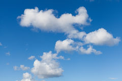 White Clouds on Bright Blue Sky Stock Photos