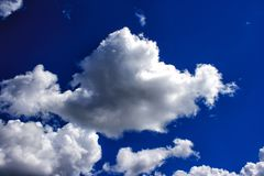 White clouds in the bright blue sky Stock Image