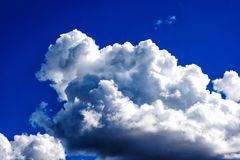White clouds in the bright blue sky Royalty Free Stock Photo