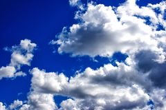 White clouds in the bright blue sky Royalty Free Stock Photography
