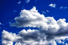 White clouds in the bright blue sky Stock Photography