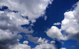 White clouds in the bright blue sky Stock Photos