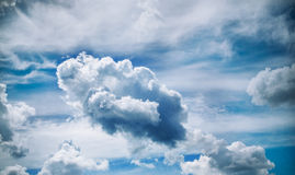 White clouds on a bright cloudy sky Stock Images