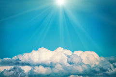White clouds and bright sun on the blue sky. Nature background, instagram colorized Royalty Free Stock Photos