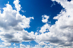 White clouds on dark blue sky. White clouds in dark blue sky that can be used as a background and in different other projects royalty free stock photos