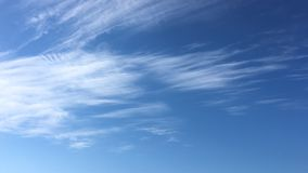 White clouds disappear in the hot sun on blue sky. Time-lapse motion clouds blue sky background. Blue sky. Clouds. Blue sky with w stock video