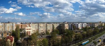 White clouds float above the city. Panoramic cityscape. Roofs of houses are trembling under the weight of clouds. Ukraine, Vinnitsa, Pirogov street Stock Photography