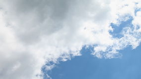 White clouds float on the blue sky. Fast movement stock video