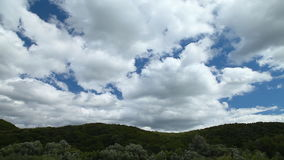 White clouds float on the blue sky. Fast movement stock video footage