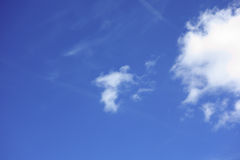 The white clouds floating on a background of blue sky Royalty Free Stock Image