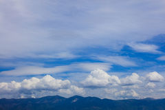 White clouds floating over land Royalty Free Stock Images