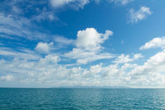 White clouds floating over ocean Stock Image