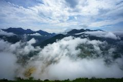 White clouds flying above mountains.  Royalty Free Stock Images