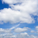 White clouds flying against blue sky. Royalty Free Stock Images