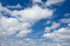 White clouds flying against blue sky. Stock Images