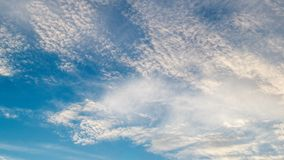 White clouds flying on blue sky. Timelapse stock video footage
