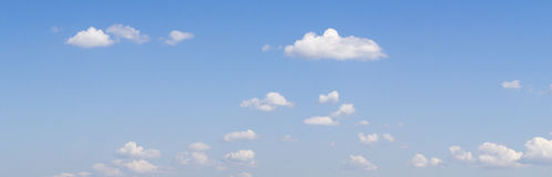 White clouds flying in deep blue summer sky Royalty Free Stock Photography