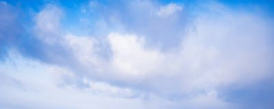 White clouds formation in blue sky at day stock images