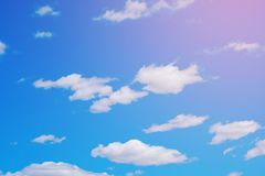 White clouds in a free idyllic blue sky on a Sunny summer day.  royalty free stock photo