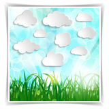 White clouds with grass silhouettes and sun rays on a Natural gr Stock Photos