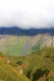 White clouds hanging over a valley in the mountains, Caucasus, G Royalty Free Stock Photography