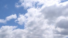 White clouds move in blue sky stock video footage