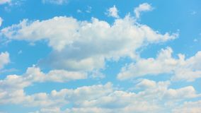White clouds moving across blue sky - timelapse stock video