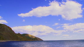 White Clouds Moving In Blue Sky Over Sea. Time stock footage