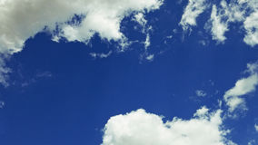 White clouds moving over blue sky. White clouds are moving over the blue sky. Fair weather concept Royalty Free Stock Images