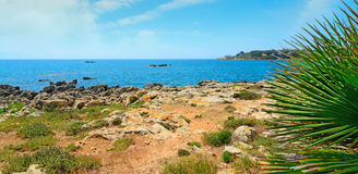 White clouds over Alghero coastline Stock Image