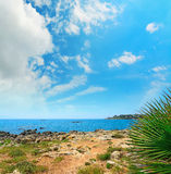 White clouds over Alghero coastline Royalty Free Stock Photos