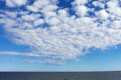 White clouds over Baltic sea. Royalty Free Stock Photography