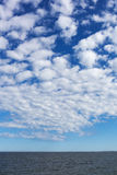 White clouds over Baltic sea. Royalty Free Stock Photos