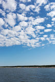 White clouds over Baltic sea. Royalty Free Stock Images