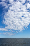 White clouds over Baltic sea. Stock Photo
