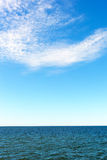 White clouds over Baltic sea. Stock Images