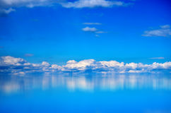 White Clouds over Blue Sea Stock Photo