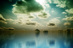 White Clouds over Blue Sea Royalty Free Stock Photography